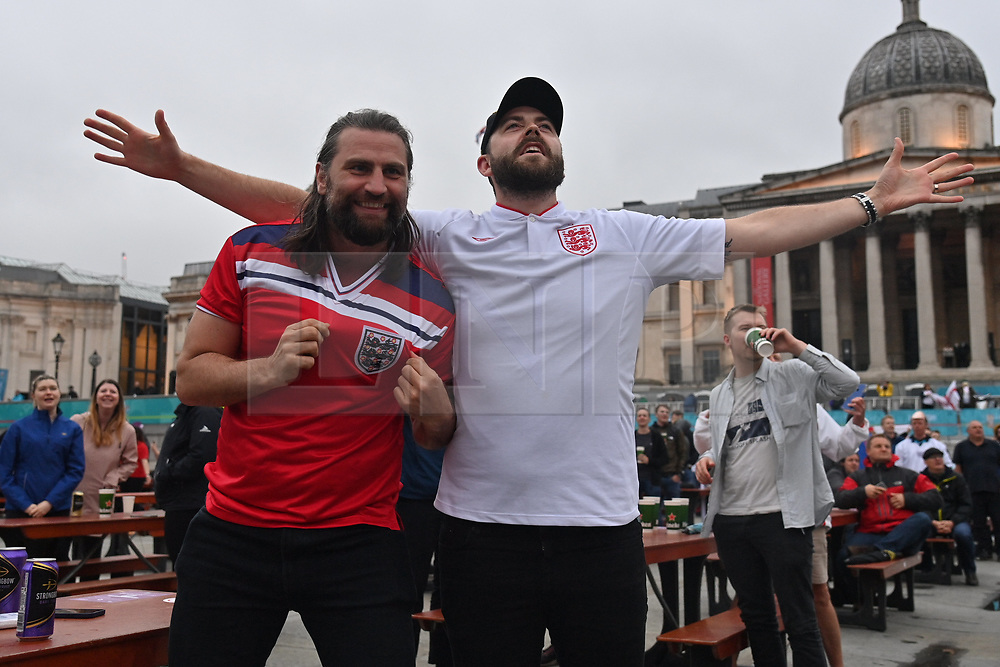© Licensed to London News Pictures. 18/06/2021. London, UK. England fans gather in the Fan Zone at Trafalgar Square in central London for England's game of the 2020 European Championship against Scotland. Today's event is attended by key workers from around the UK. Photo credit: Ray Tang/LNP