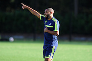 Swansea city player Ashley Williams .  Swansea city FC training at their training base in Landore  in Swansea, South Wales on Wed 23rd Oct 2013. The team are training ahead of the UEFA Europa league match v FC Kuban Krasnodar . pic by Andrew Orchard, Andrew Orchard sports photography,