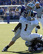 MANHATTAN, KS - NOVEMBER 17:  Linebacker Ian Campbell #98 of the Kansas State Wildcats tackles running back Jimmy Jackson #1 of the Missouri Tigers in the second quarter on November 17, 2007 at Bill Snyder Stadium in Manhattan, Kansas.  Missouri won the game 49-32.  (Photo by Peter Aiken/Getty Images)