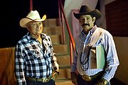 Cuban men wearing stenson hats, competitors at a Rodeo. Cuban locals attend a Rodeo in Ciego de Avila province, Cuba.
