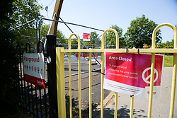 © Licensed to London News Pictures. 23/06/2020. London, UK. AREA CLOSED' sign on the gate of a playground in Chestnuts Park in north London, which has been closed and fenced since 23 March following the COVID-19 lockdown. Playgrounds will re-open from 4 July as Prime Minister Boris Johnson outlines the plans to restore normal life after three months of coronavirus lockdown. Photo credit: Dinendra Haria/LNP