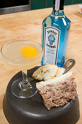 Bombay Sapphire Gin savoy cocktail by James Moreland, Goose Rillette on iron skillet prepared by Tom Mylan of Meat Hook and Brooklyn Labs. Photograph by © Jackie Neale Chadwick