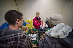 Volunteers handing out food parcels at a soup kitchen