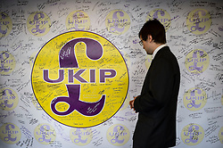 A man looks at a Ukip signature and mood board at the Ukip annual conference, Bournemouth.