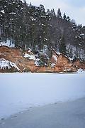 Sandstone cliff face with Greater Devil's Cave (Lielā Velnala) on cold winter morning, when river Gauja has almost frozen over, near Sigulda, Gauja National Park (Gaujas Nacionālais parks), Latvia Ⓒ Davis Ulands | davisulands.com