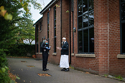 © Licensed to London News Pictures . 11/09/2020. Bolton , UK . PC TERRY WILKINSON is shown around Devonshire Education Centre and mosque by MOHAMMED BOBAT after a report that people had been gathering outside in breach of Coronavirus prevention regulations was received earlier in the afternoon . No breach was found to have occurred . Police officers from Greater Manchester Police and Environmental Health Officers from Bolton Council respond to concerns of breaches of Coronavirus regulations , as stricter lockdown measures and a curfew on hospitality businesses are imposed in the borough to limit the spread of Covid-19 . Photo credit : Joel Goodman/LNP
