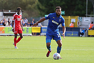 AFC Wimbledon midfielder Tom Soares (19) dribbling during the EFL Sky Bet League 1 match between AFC Wimbledon and Scunthorpe United at the Cherry Red Records Stadium, Kingston, England on 15 September 2018.