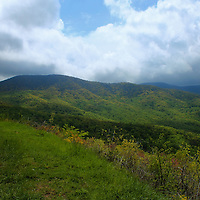 """""""Right of the Curve""""<br /> <br /> Just to the right of the beautiful stone walls on skyline drive is a wonderful view of lush green forests in the mountains and valleys below!!<br /> <br /> The Blue Ridge Mountains by Rachel Cohen"""