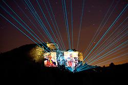 Custer, South Dakota:  Crazy Horse Memorial illuminated at night, during laser light and sound show.