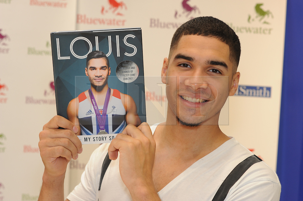 © Licensed to London News Pictures. 06/07/2013<br /> Book signing of triple Olympic medal winner and Strictly Come Dancing heartthrob Louis Smith at W H Smiths Bluewater in Kent.<br /> In 2008, Louis Smith was the first Briton in over 100 years to win an Olympic medal in individual gymnastics. In 2012 he won a silver medal in the pommel horse event at London 2012 and was a member of the bronze medal winning men's artistic all-round team. Since then, Louis has been crowned the winner of Strictly Come Dancing with his partner Flavia. <br /> <br /> Photo credit :Grant Falvey/LNP
