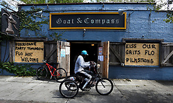 A man rides his tricycle past the open doors of the Goat & Compass bar Tuesday, September 18, 2018 in Wilmington, N.C. When owner Scott Wagner found out power was restored, he thought people could use a break from their storm problems with wi-fi, phone charging stations and air conditioning. All of this and cold beverages. Photo by Chuck Liddy/Raleigh News & Observer/TNS/ABACAPRESS.COM
