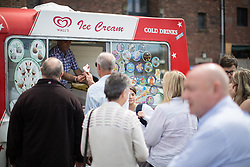 © Licensed to London News Pictures . 30/07/2016 . Liverpool , UK . People queue for free ice creams , provided by the Owen Smith campaign at a rally . The event was redirected to a field off Bridgewater Street in Liverpool when the booked venue , the Camp and Furnace warehouse , reportedly cancelled the booking . Smith is campaigning to replace Jeremy Corbyn as the leader of the Labour Party . Photo credit : Joel Goodman/LNP