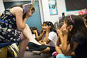 Riddhi Mundhra makes a face with her classmates as third grade teacher Laura Polden reads a book during the first day of school at Zanker Elementary School in Milpitas, California, on August 19, 2013. (Stan Olszewski/SOSKIphoto)
