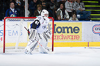 KELOWNA, CANADA - DECEMBER 5: Eetu Laurikainen #41 of the  Swift Current Broncos uses a hockey stick to defend the net as he breaks his stick at the Kelowna Rockets on December 5, 2012 at Prospera Place in Kelowna, British Columbia, Canada (Photo by Marissa Baecker/Shoot the Breeze) *** Local Caption ***