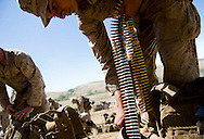 Marines from the 2nd Battalion, 5th Marine Regiment ready ammunition for their live-fire exercises at Camp Pendleton.