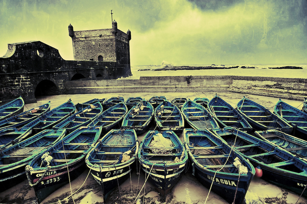 Boats rest safe at harbor during a storm in the coastal town of Essouria, Morocco.