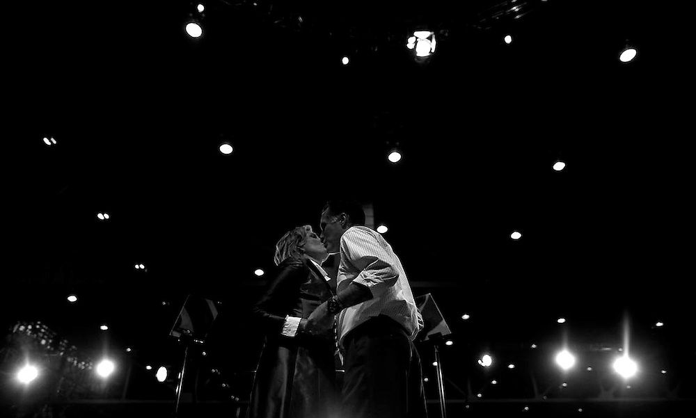 U.S. Republican presidential nominee and former Massachusetts Governor Mitt Romney kisses his wife Ann at a campaign rally in Cleveland, Ohio, November 4, 2012.  REUTERS/Jim Young