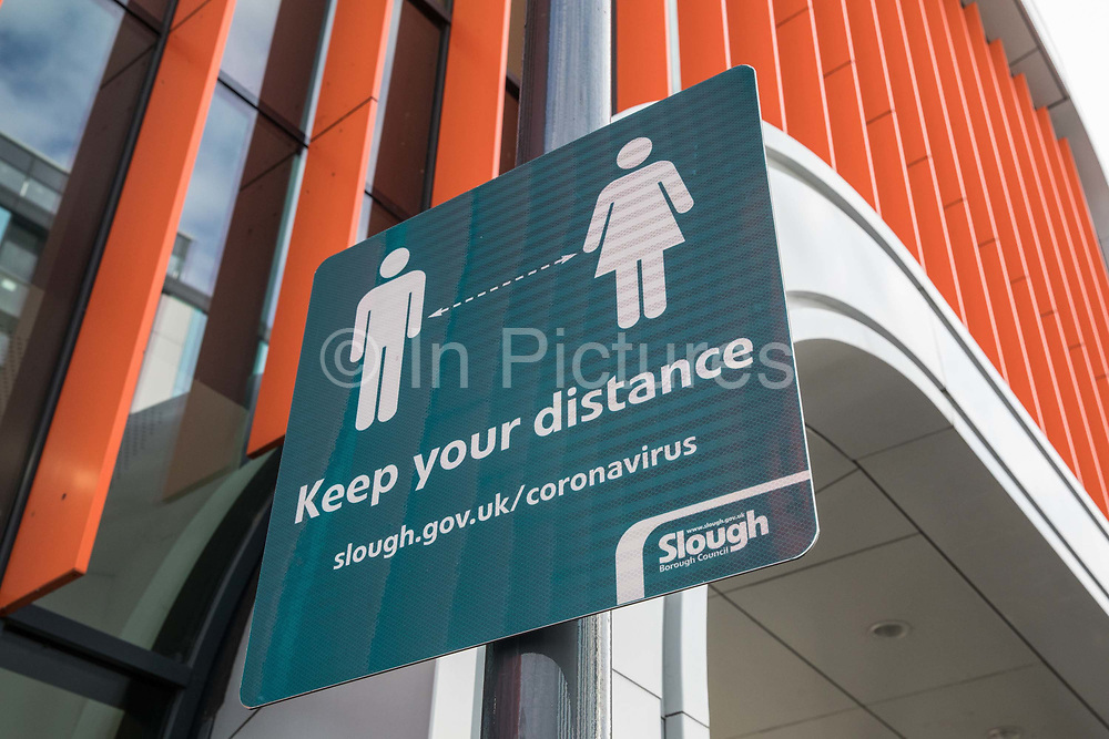 A Slough Borough Council sign reminds members of the public to keep their distance on 26th November 2020 in Slough, United Kingdom. The UK government has announced that Slough will move into Tier 3, the highest tier of coronavirus restrictions, when the second lockdown imposed to help prevent the spread of COVID-19 ends after 2nd December.