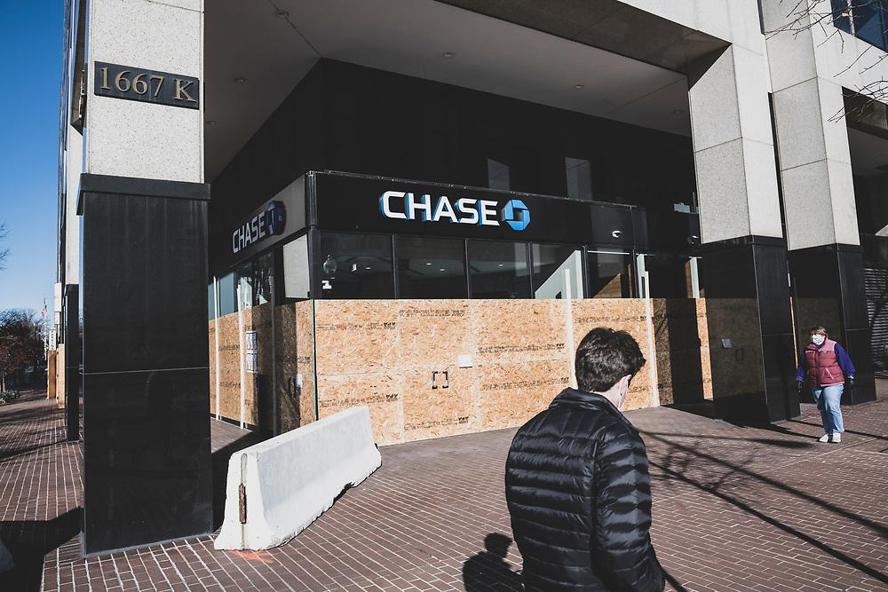 Washington DC, USA - January 19, 2021: A boarded-up entrance to Chase Bank on K Street in Washington DC.