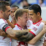 Tim Cahill, (right), New York Red Bulls, celebrates a goal by Dax McCarty (centre), along with team mate Jonny Steele, (left), during the New York Red Bulls V New England Revolution, Major League Soccer regular season match at Red Bull Arena, Harrison, New Jersey. USA. 20th April 2013. Photo Tim Clayton
