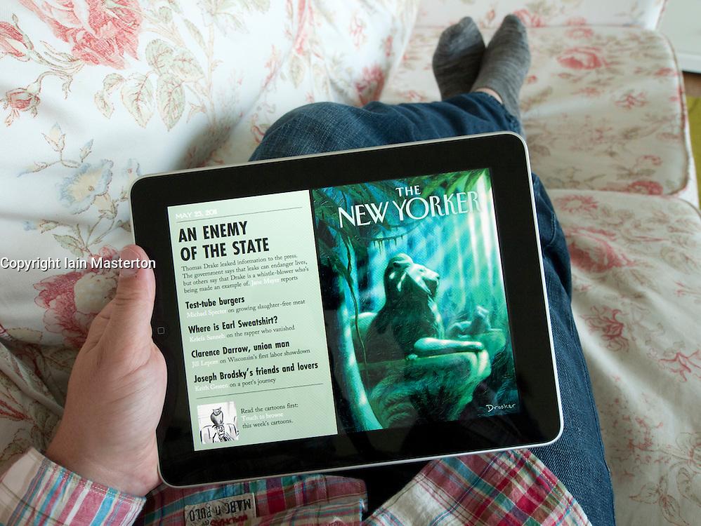 Man reading digital iPad version of New Yorker magazine