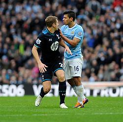 Manchester City's Sergio Aguero argues with Tottenham Hotspur's Michael Dawson - Photo mandatory by-line: Dougie Allward/JMP - Tel: Mobile: 07966 386802 24/11/2013 - SPORT - Football - Manchester - Etihad Stadium - Manchester City v Tottenham Hotspur - Barclays Premier League