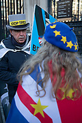 Anti Brexit protester Steve Bray talking to a colleague wearing European Union flags at Westminster outside Parliament on 15th January 2020 in London, England, United Kingdom. With a majority Conservative government in power and Brexit day at the end of January looming, the role of these protesters is now to demonstrate in the hope of the softest Brexit deal possible.