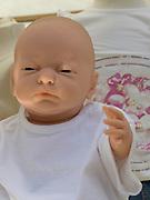 life like baby doll in crib