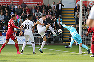 Federico Fernandez of Swansea city beats Heurelho Gomes, the Watford goalkeeper but shoots wide of goal. Premier league match, Swansea city v Watford at the Liberty Stadium in Swansea, South Wales on Saturday 23rd September 2017.<br /> pic by  Andrew Orchard, Andrew Orchard sports photography.