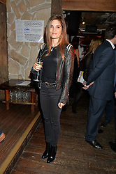 CARLY COLE wife of footballer Joe Cole at Skiing With Heroes Junior Committee Awareness Party held at Bodo's Schloss, 2A Kensington High Street, London on 6th November 2014.