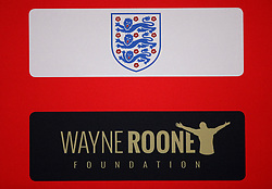 A general view of a Wayne Rooney Foundation sign and the England Three Lion's Crest during the press conference at Wembley Stadium, London.
