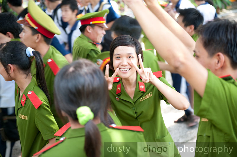 A young Vietnamese Army cadet flashes a smile and peace signs. Ho Chi Minh City (Saigon), Vietnam