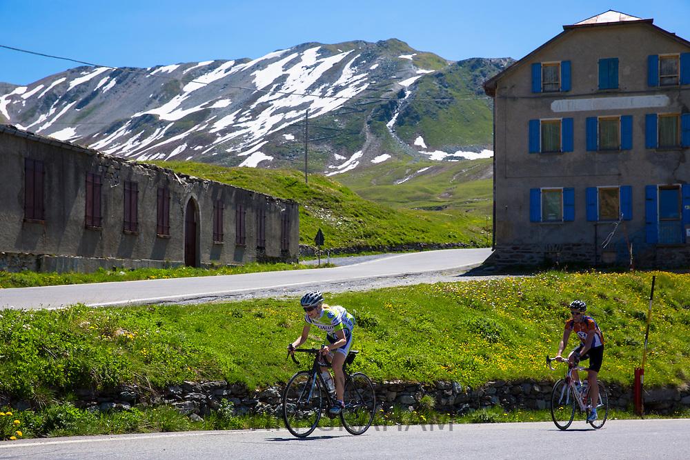 Cyclists riding British Scott bike (front) Pinarello (behind) on The Stelvio Pass, Passo dello Stelvio, Stilfser Joch, in Italy