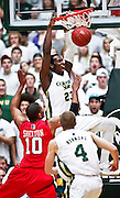 SHOT 1/28/12 3:43:25 PM - Colorado State's Will Bell #23 dunks in front of San Diego State's Tim Shelton #10 during their regular season Mountain West conference game at Moby Arena in Fort Collins, Co. Colorado State upset 12th ranked San Diego State 77-60. (Photo by Marc Piscotty / © 2012)