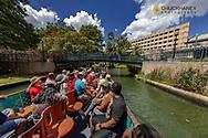 Riverboat along the Riverwalk in downtown San Antonio, Texas, USA