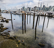 Downtown Vancouver sailboats and pilings in Coal Harbour, British Columbia, Canada. This vertical panorama was stitched from 2 overlapping images.