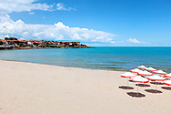 Sunny beach with white sand and blue water