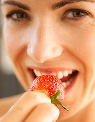 Woman Biting Strawberry