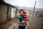 "Mother with her child  at the Roma settlement located in ""Budulovskej Street"" in Moldava nad Bodvou, Eastern Slovakia about 30 km from Kosice."