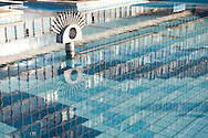 Urban textures - reflections in water with blue tiles