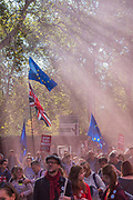 Smoke bombs are released as The march which was estimated to toal over 650,000 heads up Piccadilly - The People's Vote March For The Future demanding a Vote on any Brexit deal. The protest assembled on Park Lane and then marched to Parliament Square for speeches.