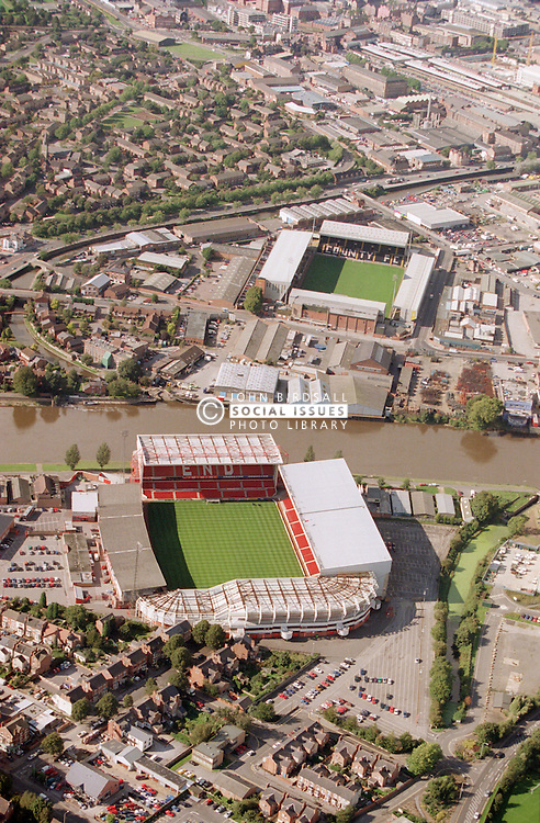 Aerial view of Notts County and Nottingham Forest football grounds, The latter is in the foreground,