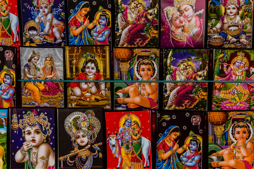 Souvenirs featuring Lord Krishna and Radha,Holi (festival of colors), Mathura (birthplace of Krishna), Uttar Pradesh, India.