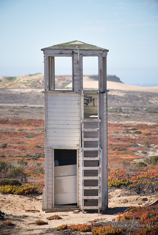 An abandoned tower overlooking a sand dune shooting range at Fort Ord, California