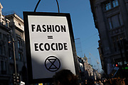 Extinction Rebellion protest during Black Friday event at Oxford Circus on the 29th November 2019 in central London in the United Kingdom. Black Friday is a shopping event that originated from the US where retailers cut prices on the day after the Thanksgiving holiday. Extinction Rebellion are calling to boycott fashion and excessive consumerism.