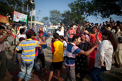 © under license to London News Pictures.  17/10/2010 ©London News Pictures. 17/10/2010. Devotees dance and celabrate after carrying an idol of Hindu goddess Durga immersing it in the river Ganges on the last day of the Durga Puja festival on October 17, 2010 in Kolkata, India. The festival is the biggest of the year in the Indian state of Bengal and celebrates the worship of the Hindu Goddess Durga, who in Hindu Mythology is celebrated as the Goddess of power and the victor of good over evil.