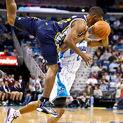 December 17, 2010; New Orleans, LA, USA; Utah Jazz point guard Ronnie Price (17) collides with New Orleans Hornets point guard Jarrett Jack (2) during the second half at the New Orleans Arena.  The Hornets defeated the Jazz 100-71. Mandatory Credit: Derick E. Hingle