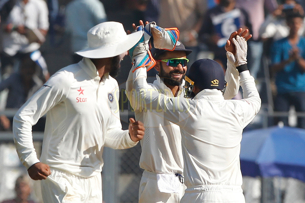 Virat Kohli Captain of India along with team mates celebrates their win against England during day 5 of the fourth test match between India and England held at the Wankhede Stadium, Mumbai on the 12th December 2016.<br /> <br /> Photo by: Deepak Malik/ BCCI/ SPORTZPICS