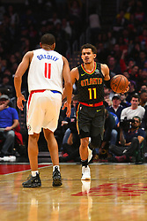 January 28, 2019 - Los Angeles, CA, U.S. - LOS ANGELES, CA - JANUARY 28: Atlanta Hawks Guard Trae Young (11) brings the ball up the court defended by Los Angeles Clippers Guard Avery Bradley (11) during a NBA game between the Atlanta Hawks and the Los Angeles Clippers on January 28, 2019 at STAPLES Center in Los Angeles, CA. (Photo by Brian Rothmuller/Icon Sportswire) (Credit Image: © Brian Rothmuller/Icon SMI via ZUMA Press)