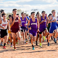 The boys varsity leave the start line at the Grants High School Invitational cross country meet in Grants Friday.